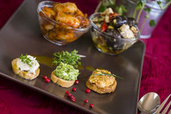 Selection of Appetizers on Square Plate on Table Royalty Free Stock Images