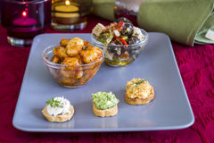 Selection of Appetizers on Square Plate on Table Royalty Free Stock Photos