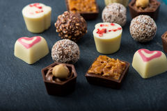 Selection of artisan chocolates praline on black background Royalty Free Stock Images