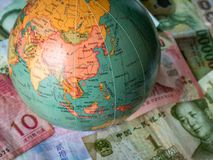 Selection of Asian Money Currency banknotes with globe stock photography