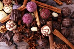 A selection of assorted chocolate truffle pralines on a wooden t. Able with dark chocolate, cinnamon and anise Stock Images