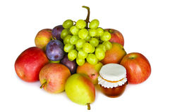 Selection of autumn fruits and honey isolated Stock Image