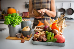 Selection of Autumn fruits and vegetables on kitchen counter. A tray full of Autumn fruits, nuts, and vegetables sits on a kitchen counter. Next to the tray, a Royalty Free Stock Photography