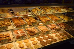 Selection of baked goods for sale in Frency bakery. Baked goods for sale in a French patisserie Royalty Free Stock Photos