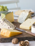 Selection of British Cheeses with Walnuts Biscuits Royalty Free Stock Image