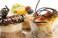 Selection of cakes. Close-up of a various mousse cakes with fruit and chocolate Stock Photo