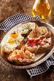 Selection of canapes on a rustic dish royalty free stock photos