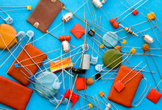 Selection of capacitors. A variety or selection of leaded capacitors used in electronics circuits royalty free stock images
