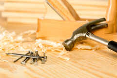 Selection of carpenter tools. Carpenter tools on the wooden background Stock Photos