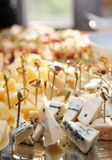 Selection of cheese on banquet table Stock Photography