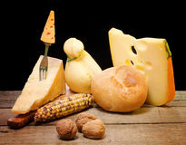 Selection of cheese over wooden table Royalty Free Stock Photography