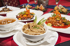 Selection of chinese food in a restaurant. Various selection of chinese meals on table in restaurant Royalty Free Stock Photo