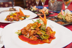 Selection of chinese food in a restaurant. Various selection of chinese meals on table in restaurant Stock Image