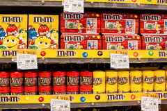 Selection of chocolate candy M&M's on the shelves in a supermarket Siam Paragon in Bangkok. Royalty Free Stock Images