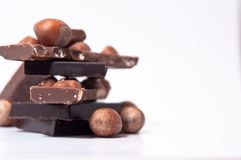 Selection of chocolate squares and nuts Royalty Free Stock Photos
