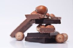 Selection of chocolate squares and nuts Stock Images