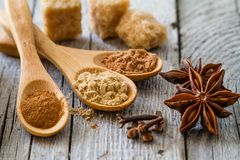 Selection of christmas spices on rustic wood background. Closeup Royalty Free Stock Photo