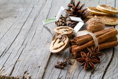 Selection of christmas spices on rustic wood background. Copy space Stock Image
