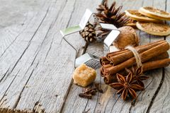 Selection of christmas spices on rustic wood background. Copy space Royalty Free Stock Image