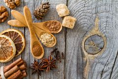 Selection of christmas spices on rustic wood background. Top view Royalty Free Stock Photo