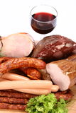 Selection of cold meat and wine Royalty Free Stock Photography