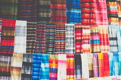 Selection of colorfu clothes on a traditional Moroccan market s. Ouk in Marrakech, Morocco Royalty Free Stock Photos