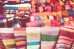Selection of colorfu clothes on a traditional Moroccan market s. Ouk in Marrakech, Morocco Stock Photo