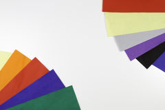 Selection of colorful felt sheets arranged as border frame on white background. Top view stock image