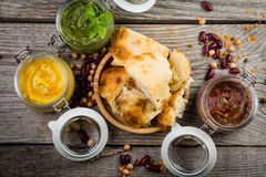 Selection of colorful hummus in jars Stock Photos