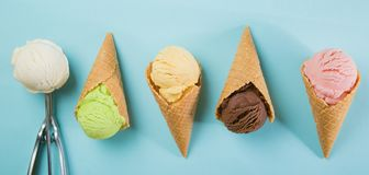 Selection of colorful ice cream scoops on blue background. Top view royalty free stock photos