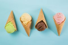 Selection of colorful ice cream scoops on blue background. Top view stock photos