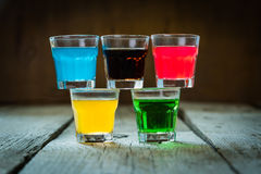 Selection of colorful shot drinks on white wood background stock photos