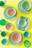 Selection of colorful tableware on bright yellow background stock photos