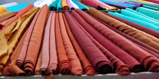 Selection of colorful fabrics for sale Stock Photos