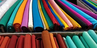 Selection of colorful fabrics for sale stock image