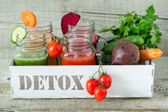 Selection of colorful vegetable juices in glass jars royalty free stock photography