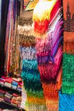 Colorful women scarves at a market. Selection of colorful women scarves at a market Royalty Free Stock Images