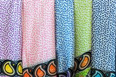 Colorful women scarves at a market. Selection of colorful women scarves at a market Stock Photo