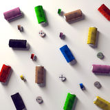 A selection of coloured spools and bobbins Stock Images