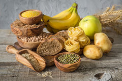 Selection of comptex carbohydrates sources on wood background. Copy space Stock Image