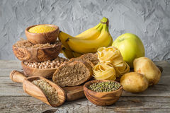 Selection of comptex carbohydrates sources on wood background Royalty Free Stock Images