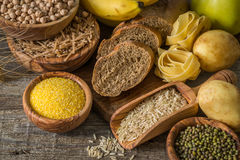 Selection of comptex carbohydrates sources on wood background Royalty Free Stock Image