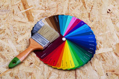 Selection of the correct paint. Color palette for selection and paint brush royalty free stock image