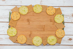 Selection of crackers on wooden board Royalty Free Stock Image