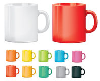 Selection of cups or mugs in different colours Royalty Free Stock Images