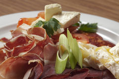 Selection of cured meats and cheese Stock Photo