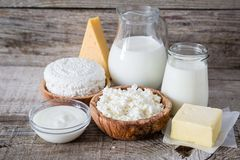 Selection of dairy products on rustic wood bacground Stock Images