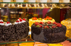 Selection of Decadent Cakes in Window Display Stock Photos
