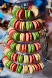 Selection of decorative desserts on buffet table at catered event Stock Photos