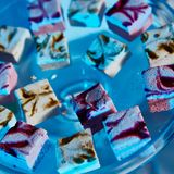 Selection of decorative desserts on buffet table at catered event Royalty Free Stock Image
